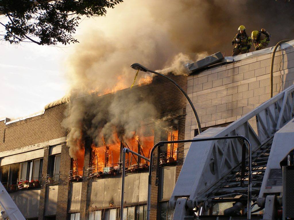 Fire - Fire fighters keep on working to save the building
